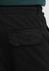 Urban Classics - Cargo trousers - black - 5