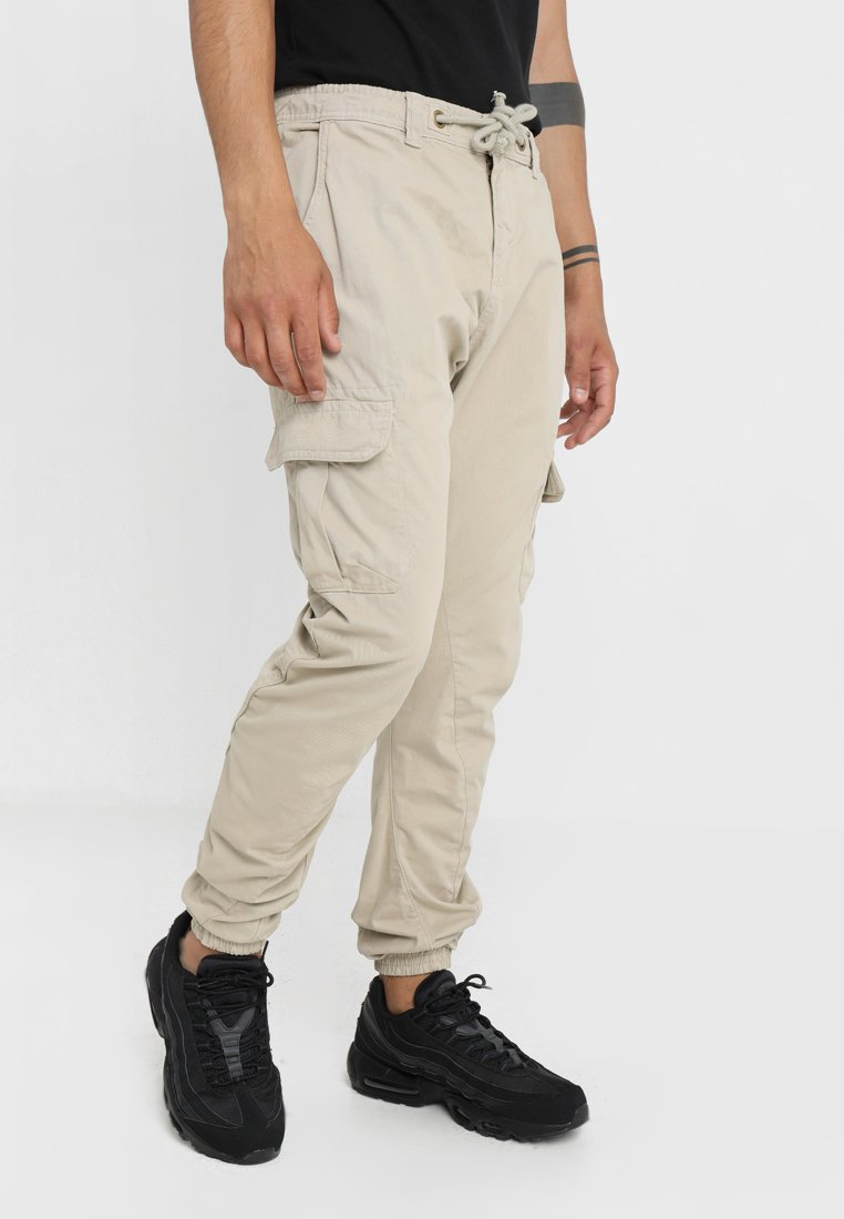 Urban Classics - JOGGING PANT - Cargo trousers - sand