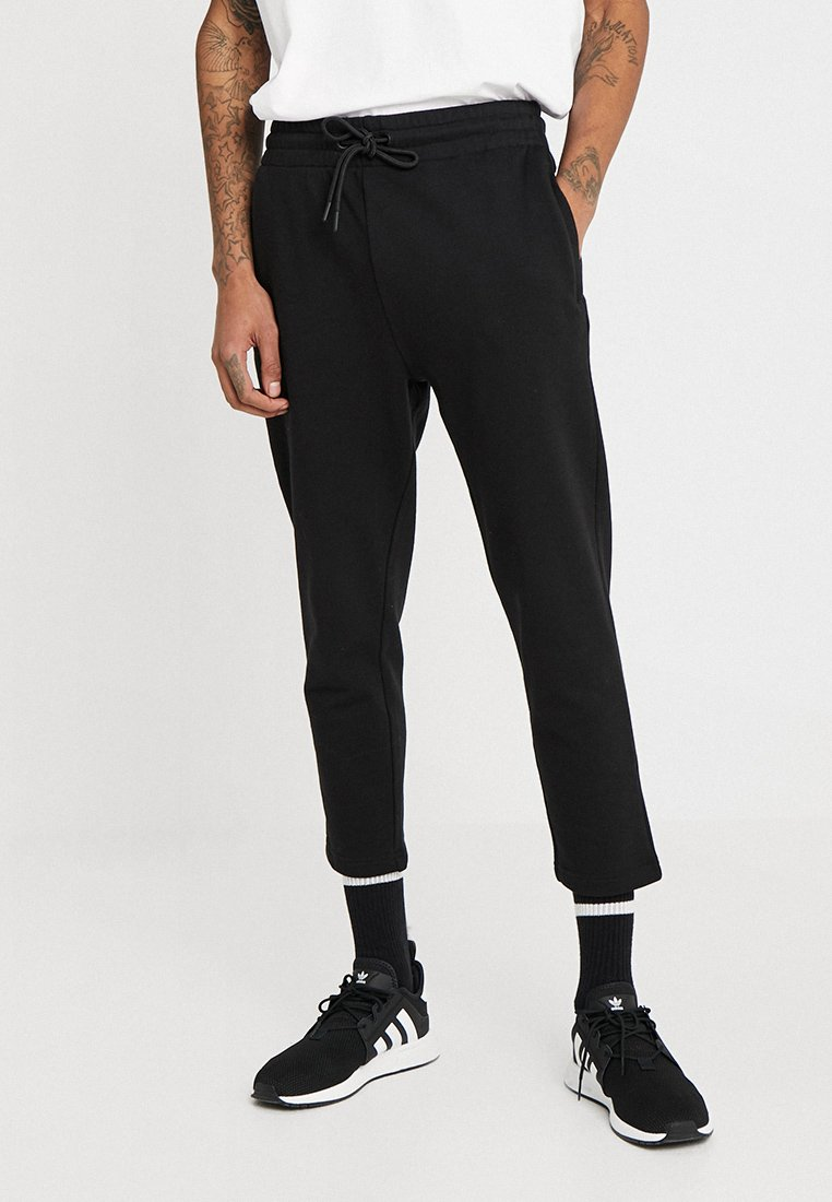 Urban Classics - CROPPED TERRY PANTS - Jogginghose - black