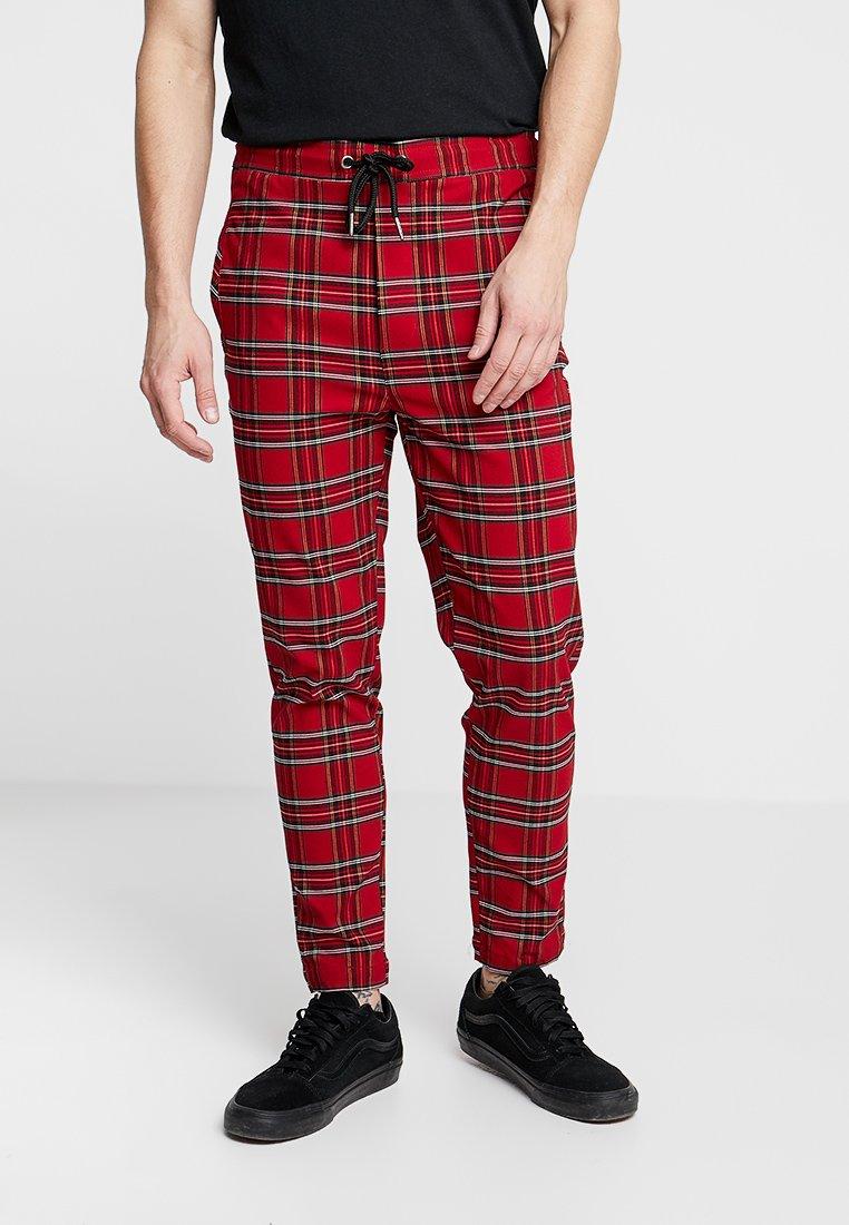 Urban Classics - TARTAN PANTS - Trousers - red/black