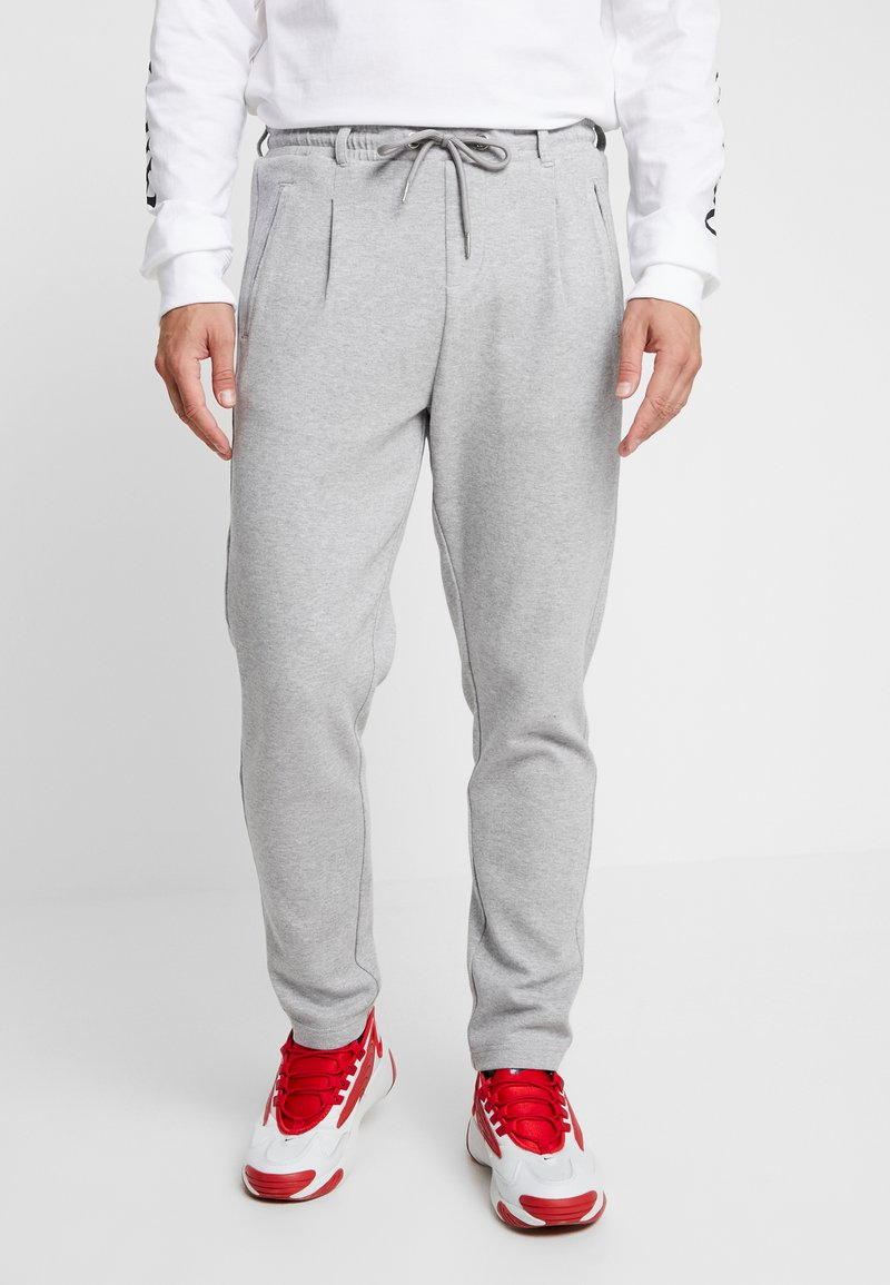 Urban Classics - FORMULA CROPPED PEACHEDINTERLOCK PANTS - Tracksuit bottoms - black