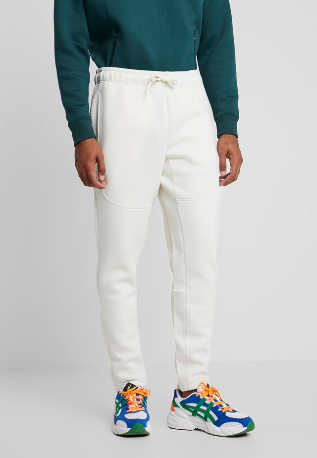 CUT AND SEW PANTS - Tracksuit bottoms - sand