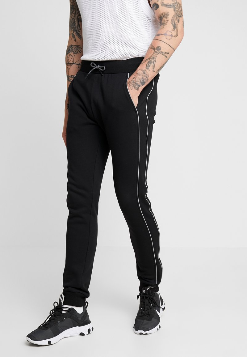 Urban Classics - REFLECTIVE - Trainingsbroek - black