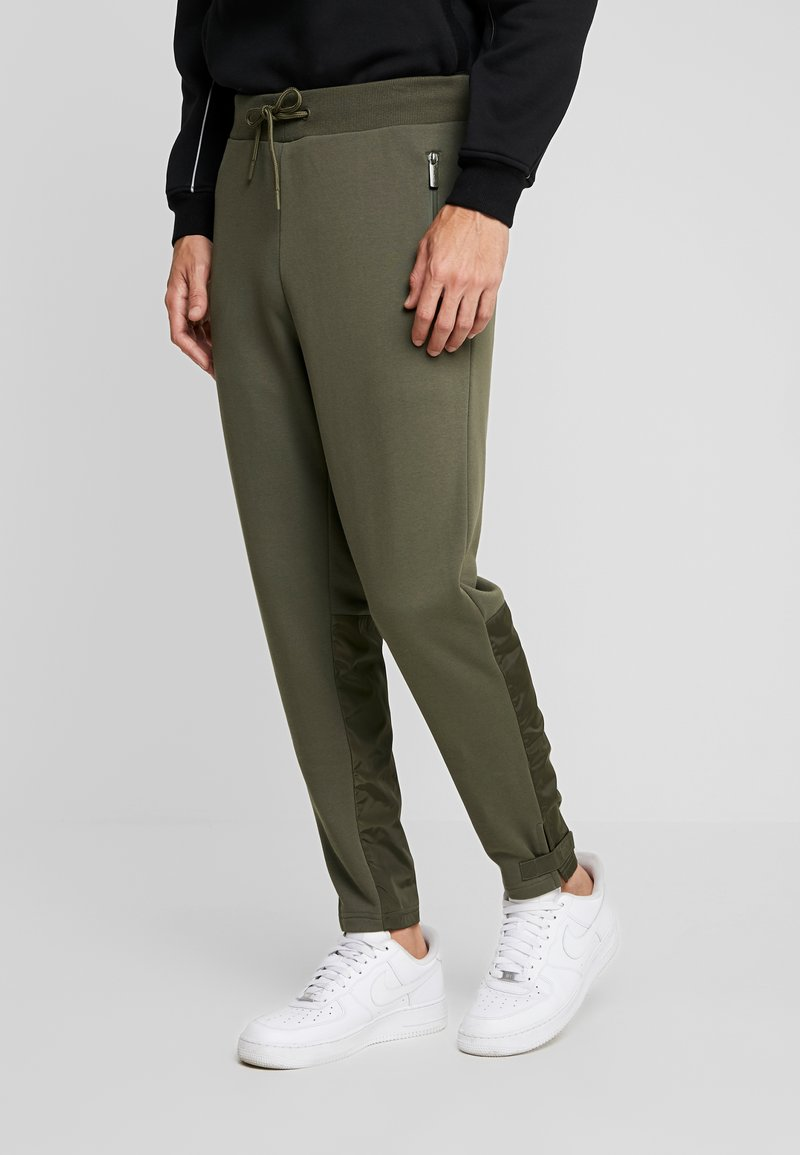 Urban Classics - MILITARY - Tracksuit bottoms - olive