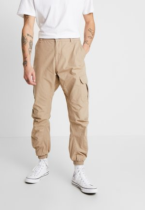 RIPSTOP PANTS - Cargo trousers - beige