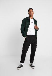 Urban Classics - RIPSTOP CARGO PANTS - Pantalones cargo - black - 1