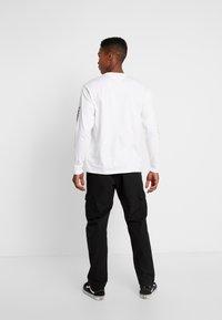 Urban Classics - RIPSTOP CARGO PANTS - Pantalones cargo - black - 2