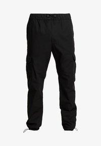 Urban Classics - RIPSTOP CARGO PANTS - Pantalones cargo - black - 3