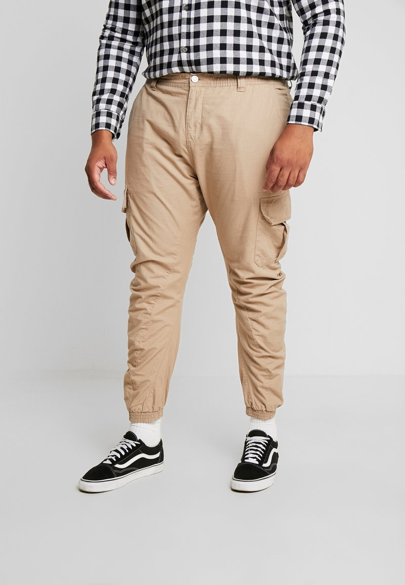 Urban Classics - RIPSTOP PANTS - Cargo trousers - beige
