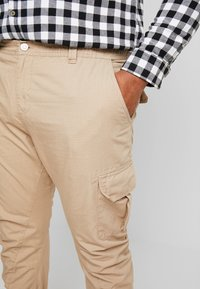 Urban Classics - RIPSTOP PANTS - Cargo trousers - beige - 3