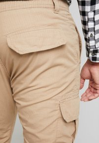 Urban Classics - RIPSTOP PANTS - Cargo trousers - beige - 5
