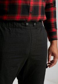 Urban Classics - RIPSTOP PANTS  - Cargo trousers - black - 3