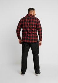 Urban Classics - RIPSTOP PANTS  - Cargo trousers - black - 2