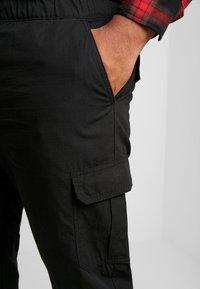 Urban Classics - RIPSTOP PANTS  - Cargo trousers - black - 4