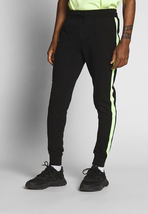 NEON STRIPED SWEATPANTS - Trainingsbroek - black/neonyellow