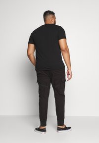 Urban Classics - TACTICAL TROUSER - Cargo trousers - black - 2