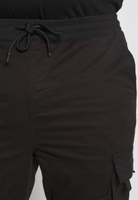 Urban Classics - TACTICAL TROUSER - Cargo trousers - black - 5