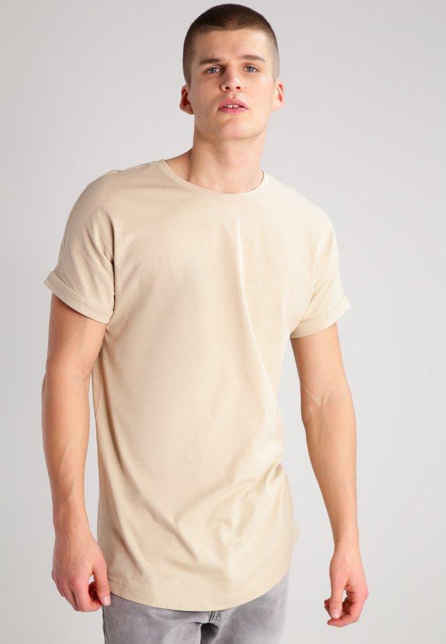 LONG SHAPED TURNUP - Basic T-shirt - sand