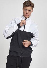 Urban Classics - Training jacket - black/white - 0