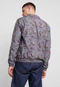 Urban Classics - Training jacket - darkdesert - 2