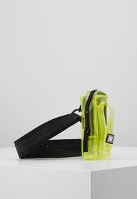 Urban Classics - UTILITY BELTBAG TRANSPARENT - Bum bag - yellow - 4