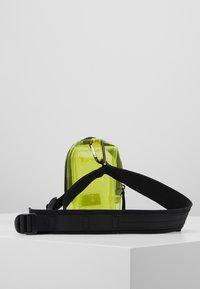 Urban Classics - UTILITY BELTBAG TRANSPARENT - Bum bag - yellow - 3