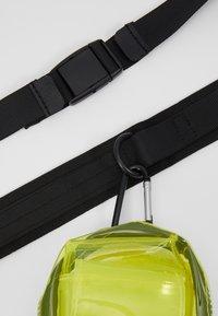 Urban Classics - UTILITY BELTBAG TRANSPARENT - Bum bag - yellow - 2