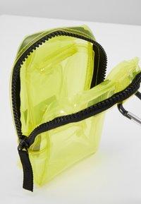 Urban Classics - UTILITY BELTBAG TRANSPARENT - Bum bag - yellow - 5