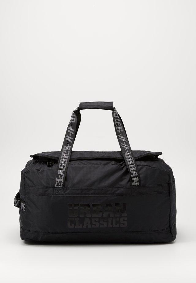 SOFT TRAVELLER BAG - Weekend bag - black