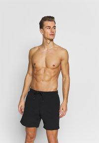 Urban Classics - TAPED SWIM - Shorts da mare - black - 1