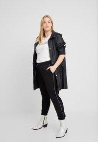 Urban Classics Curvy - LADIES REFLECTIVE  - Pantalones deportivos - black - 1