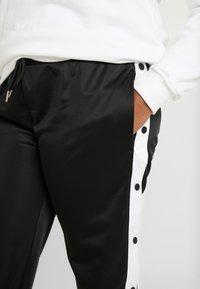 Urban Classics Curvy - LADIES BUTTON UP TRACK PANTS - Tracksuit bottoms - black - 4