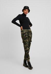 Urban Classics - LADIES CARGO PANTS - Spodnie treningowe - woodcamo/black - 1