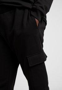 Urban Classics - LADIES CARGO PANTS - Tracksuit bottoms - black - 4