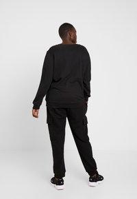 Urban Classics - LADIES CARGO PANTS - Tracksuit bottoms - black - 2