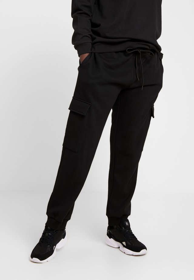 LADIES CARGO PANTS - Verryttelyhousut - black