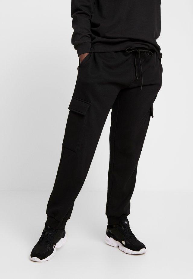 LADIES CARGO PANTS - Træningsbukser - black