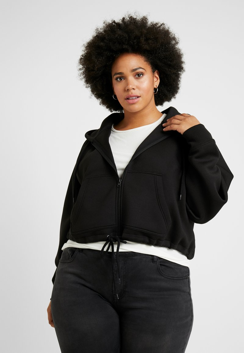 Urban Classics Curvy - LADIES OVERSIZED SHORT RAGLAN ZIP HOODY - veste en sweat zippée - black