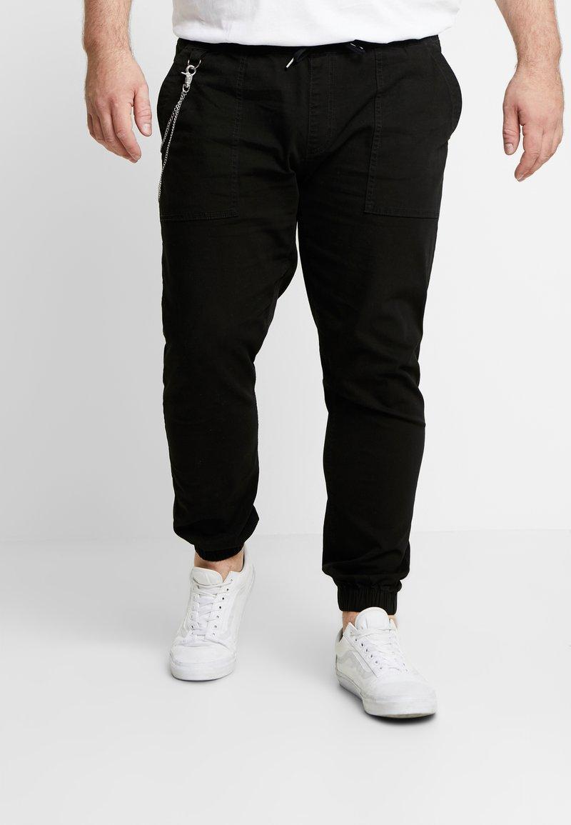 URBN SAINT - TRISTEN PANTS - Trousers - black