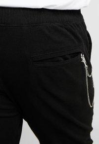 URBN SAINT - TRISTEN PANTS - Trousers - black - 5