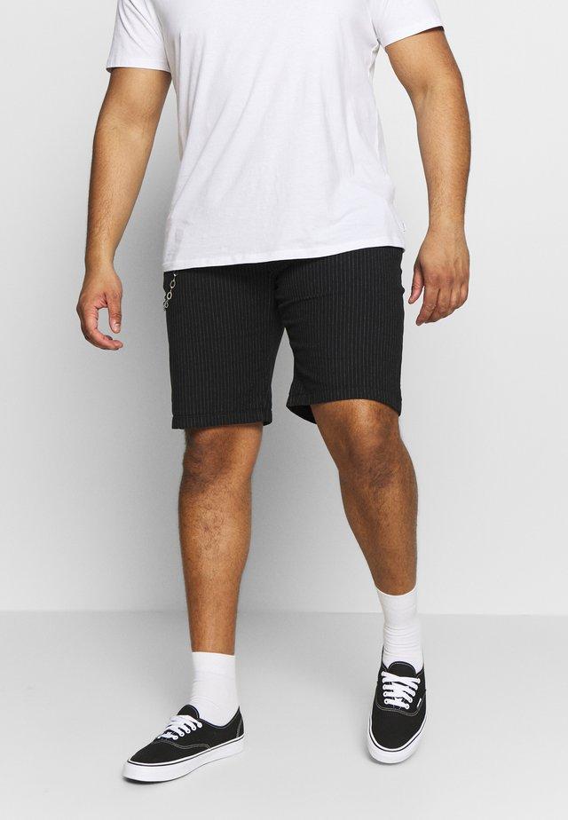 USLUCA - Shorts - black