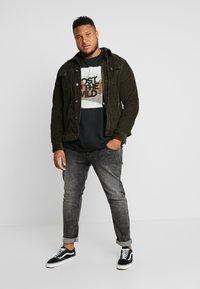 URBN SAINT - BERLIN - Slim fit jeans - acid black - 1