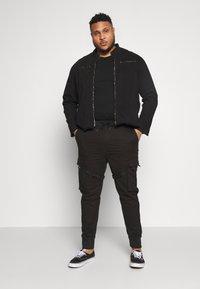 URBN SAINT - USMESA JACKET - Summer jacket - black - 1
