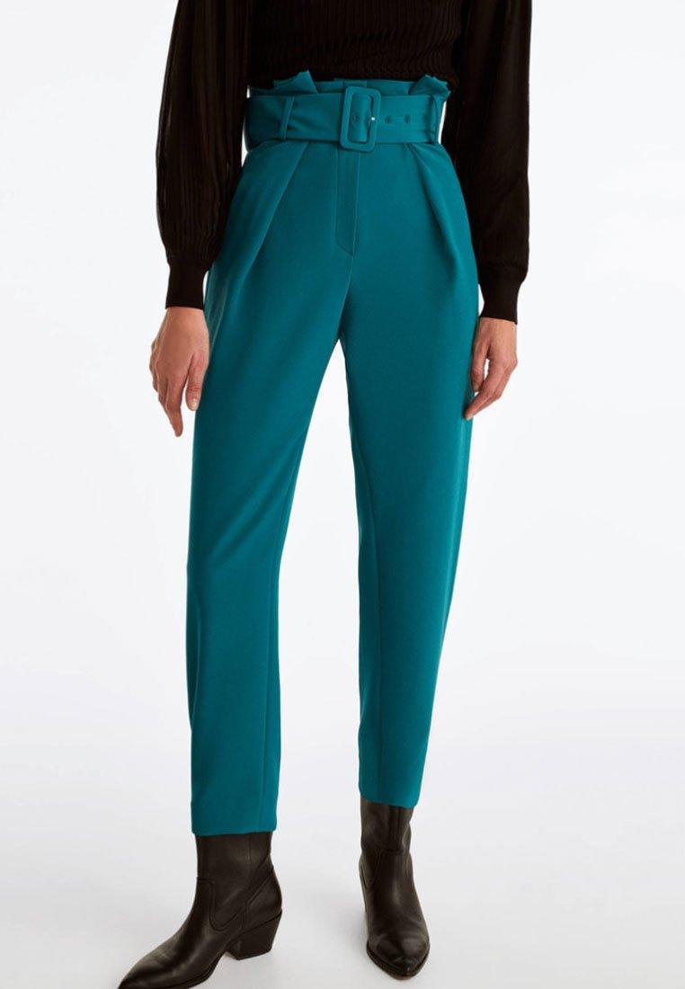 Uterqüe - MIT ZIERFALTEN - Tygbyxor - turquoise