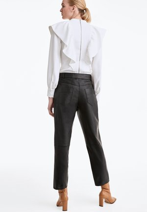 MIT SCHNALLE  - Leather trousers - black