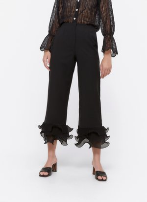 MIT VOLANT  - Trousers - black
