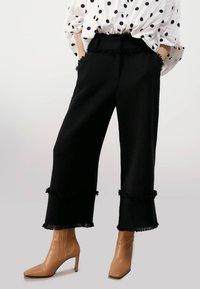 Uterqüe - Trousers - black - 0