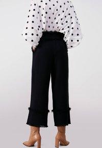 Uterqüe - Trousers - black - 2