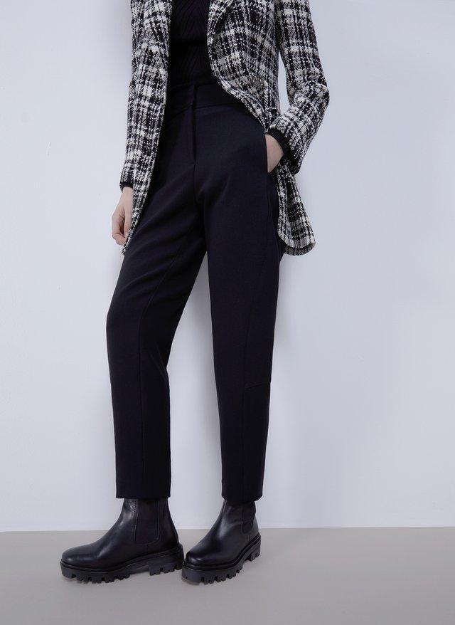MIT STEPPNÄHTEN - Trousers - black
