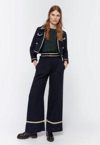 Uterqüe - MIT PASPELN - Trousers - dark blue - 1